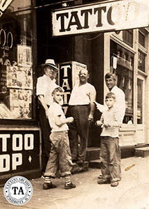 This photo was taken in the early 1940s on Main Street, Norfolk Virginia. Left to Right is, Jack Wills, Walter Cleveland, Paul Rogers and his sons Leonard and Willis