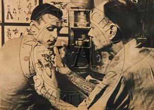 Newspaper photograph of Tatts Thomas at work, c1950s